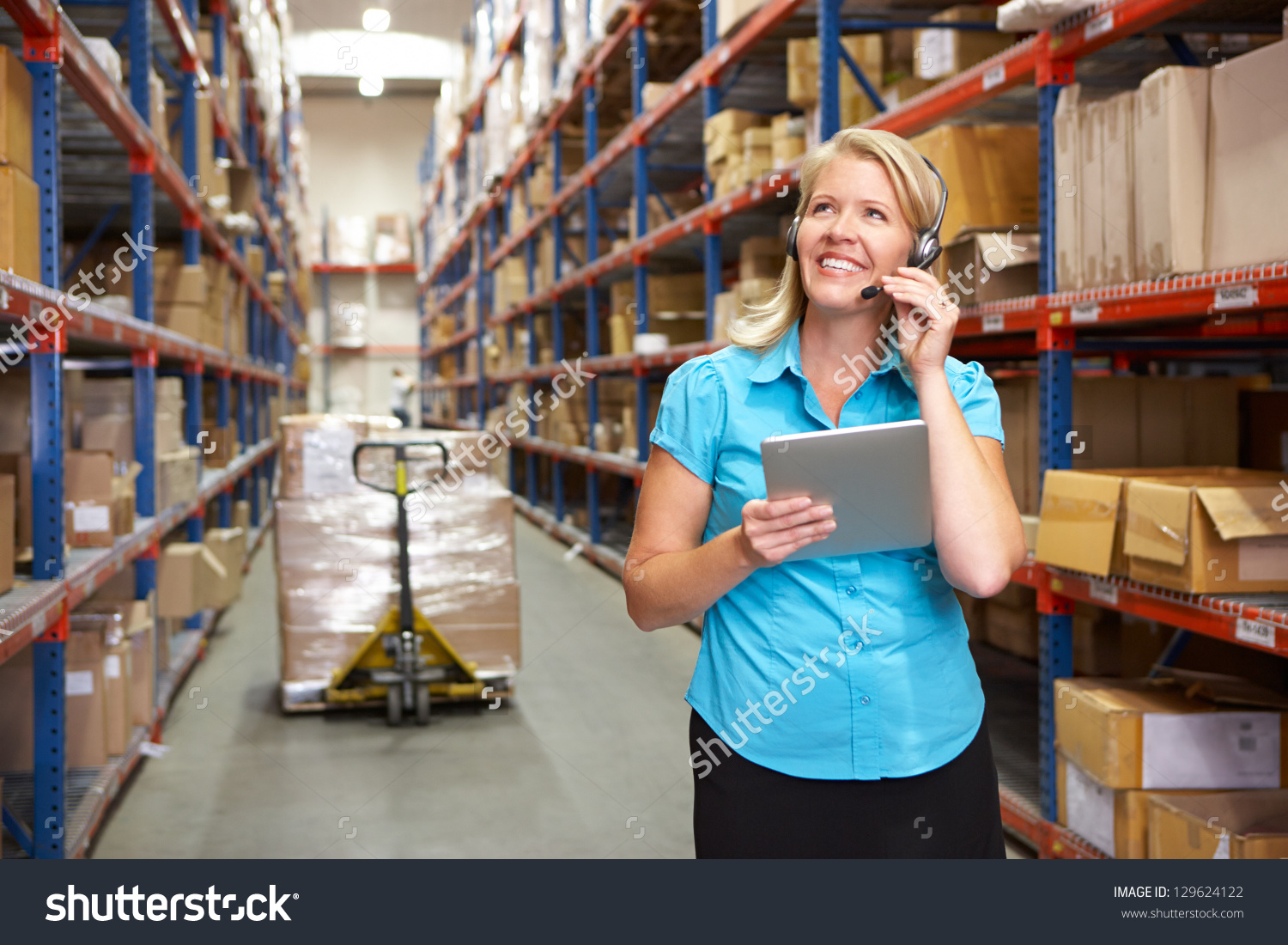 stock-photo-businesswoman-using-digital-tablet-in